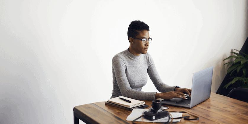 woman writing resume skills section